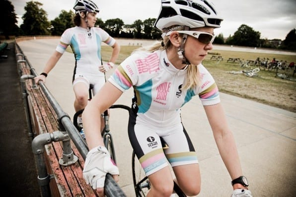 Two female track cyclists taking a break.