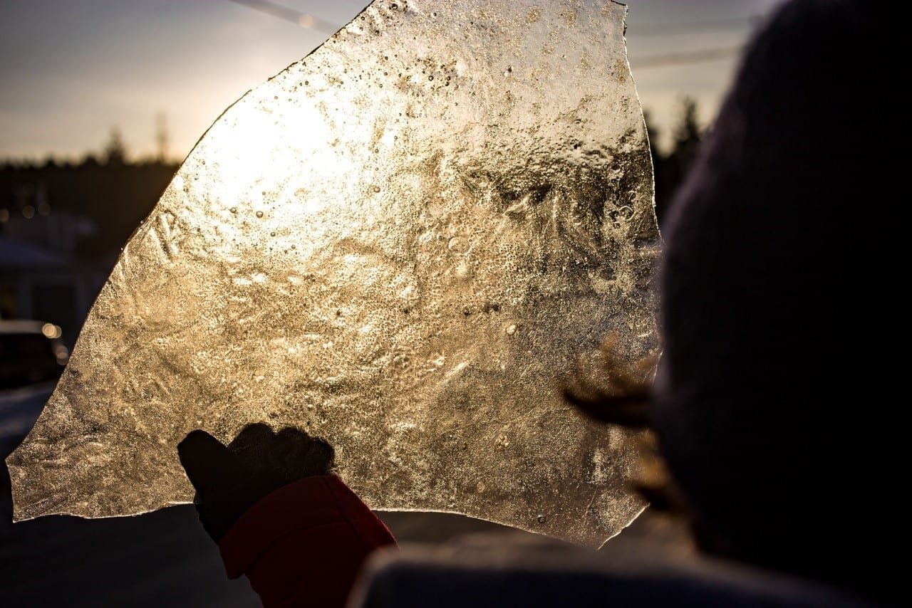 Ice Chunk being held up and reflecting sunset light.