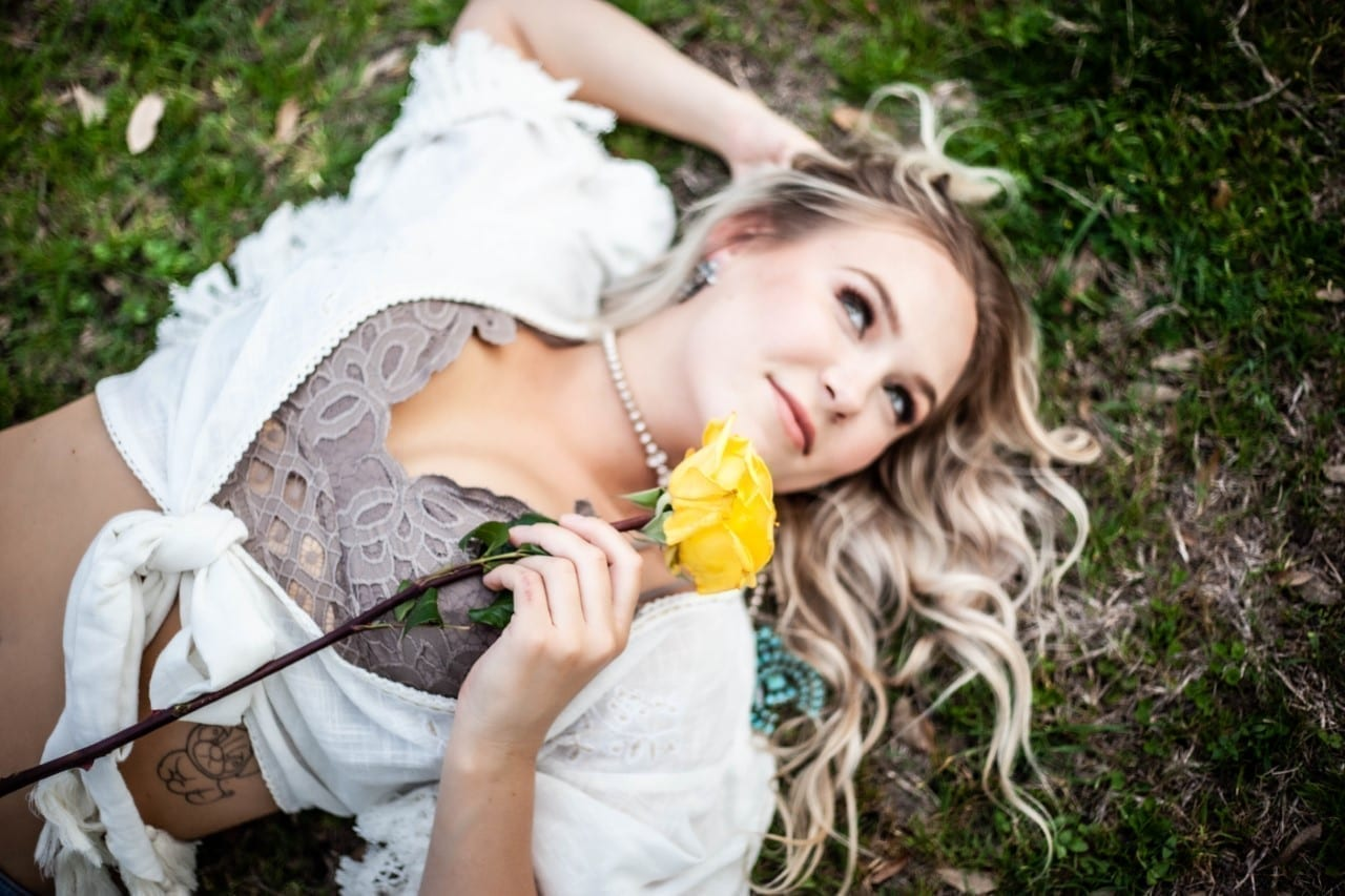 Teigan Gayse lying in the grass.